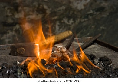 blacksmith tools in fire