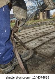 Blacksmith using rasp,  hoof knife and hoof cut nippers. Clearing of hind horse hoof hold in holder.