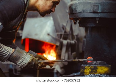 blacksmith working in the forge