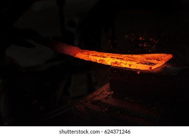Blacksmith working on a piece of metal