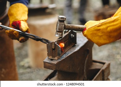 The blacksmith's anvil is made of forged or cast steel, wrought iron with a hard steel face, or cast iron with a hard steel face. People's blacksmith working iron with a hammer and anvil