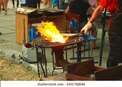 The blacksmith's anvil is made of forged or cast steel. Furnace for blacksmiths. Equipment for forging steel. Blacksmiths Festival of craftsmanship, street exhibition of forging metal.