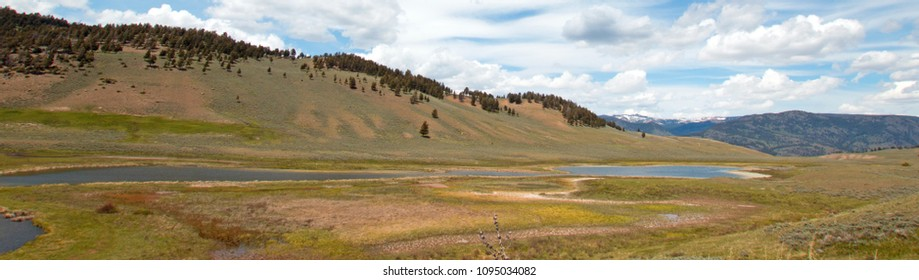 Blacktail Lakes under cirrus lenticular cloudscape in Yellowstone National Park in Wyoming USA