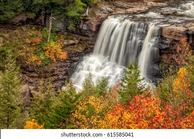 Blackwater Falls This is one of West Virginia's lovely fall waterfall scenes. Photographed in October, the leaves are changing, falls are roaring, and nature is beautiful.