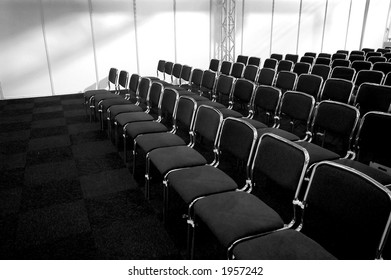 black/white picture of black business chairs, ready for a conference