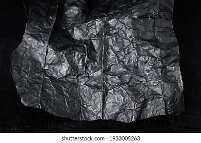 blackwrap used in filmmaking to direct light close-up on a black background