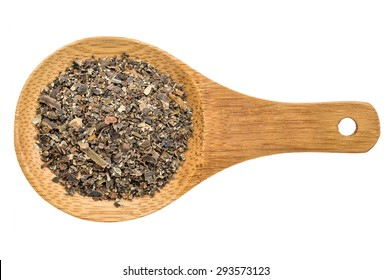 bladderwrack  seaweed flakes - top view of a wooden spoon isolated on white