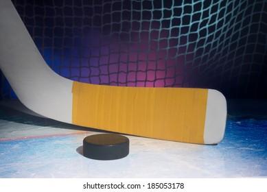 Blade of goalie hockey stick on ice. On smoky background