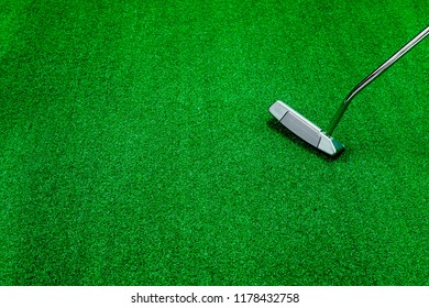 Blade milled putter placed on artificial grass with space for text/sentence