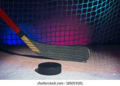 Blade of wooden hockey stick on ice. On smoky background