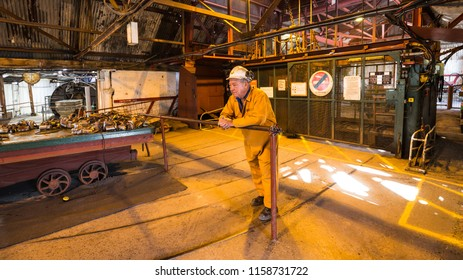 Blaenavon,Wales, UK - July, 25, 2018: Old miner and guide at heritage site Blaenavon Colliery Big Pit Natiional Museum in Wales, UK