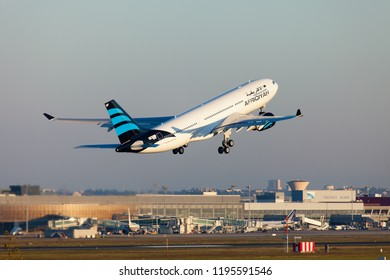 Blagnac Airport, Toulouse / France - 12.11.2013. Airbus Plant. Modern passenger aircraft Airbus A330 of Afriqiyah Airlines takes off from the airport runway.