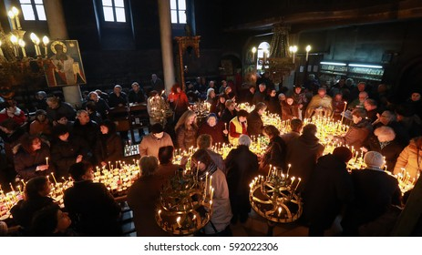 Blagoevgrad, Bulgaria - February 10, 2017: Hundreds of jars of honey rank in the form of the Holy Cross in honor of Saint.Haralampiy