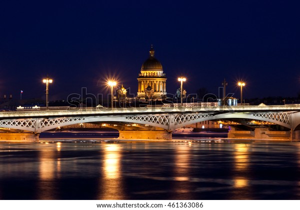 Blagoveshchensky (Leuteinant Schmidt) bridge and St. Isaac Cathedral in St.Petersburg, Russia. White night view from embankment.