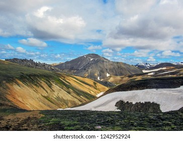 Blahnukur mountain and rhyolite mountains covered with snow in Landmannalaugar geothermal region, South Iceland