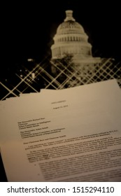 Blaine, WA / USA – September 26, 2019: The Whistle Blower Report to Congress on President Trump's solicitation of political favors from the president of Ukraine, with background of US Capitol.