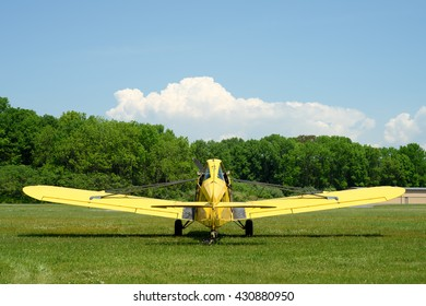 Blairstown, NJ, USA - May 28, 2016: A yellow propeller plane used for towing glider planes at the Blairstown Airport on May 28, 2016.