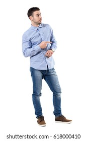 Blaming or accuse concept. Young businessman pointing finger looking away. Full body length portrait isolated over white background.