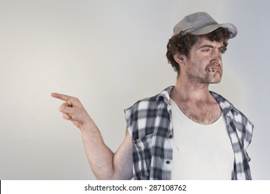 Blaming redneck bosses everyone around as he smokes his cigarette
