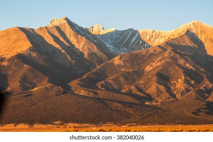 Blanca Peak and Sunset Golden Hour Alpine Glow on High 14ers high altitude Mountain Peaks in the Sangre De Cristo Range of the Rocky Mountains of Colorado