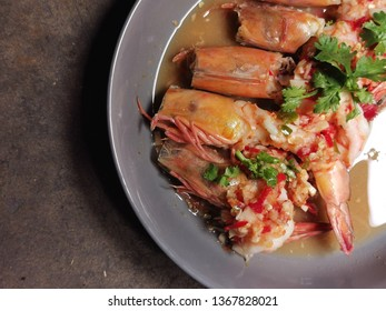 blanched shrimps in chili and garlic seafood sauce on cement surface