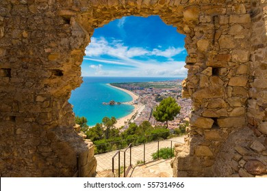 Blanes beach through a stone door of St. John Castle. Aerial panoramic view in Costa Brava in a beautiful summer day, Spain
