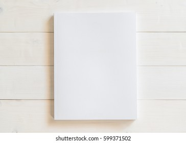 Blank A4 size book cover mockup template with page front side on white surface on wood table