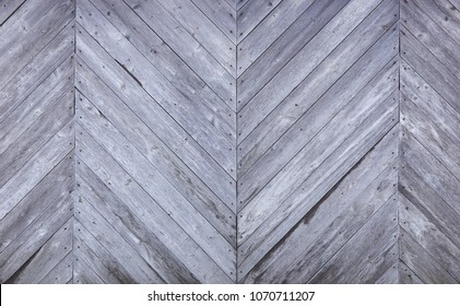 Blank abstract background of gray wooden panels. Surface of a wooden fence is a texture. Diagonal boards.