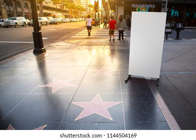 Blank advertisement banner stand and Hollywood stars walk of fame in Hollywood Boulevard, LA California.