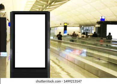Blank advertisement billboard poster mock up at airport with long walkalator and blurred people as background