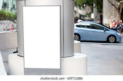 Blank advertisement billboard,banner in outdoor street with blurred car as background