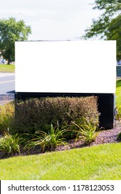 Blank advertisement board with clipping path and copy space in suburban area.