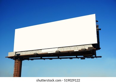 blank advertisement board outdoor against blue sky ready for text