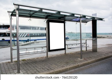 blank advertisement in a bus stop next to the sea and ships in istanbul city