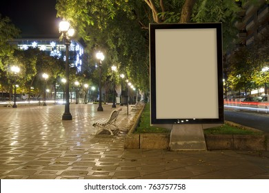 Blank advertisement mock up in a public park at night