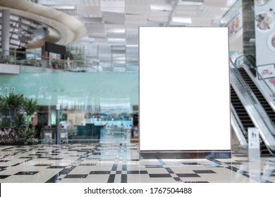 Blank advertising banner mockup in modern airport retail environment; large digital display screen. Billboard, poster, out-of-home OOH media display space.