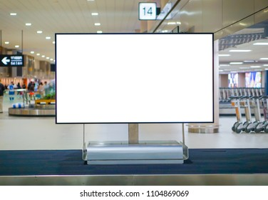 Blank advertising billboard in the Airport with path. Baggage conveyor belt at the airport