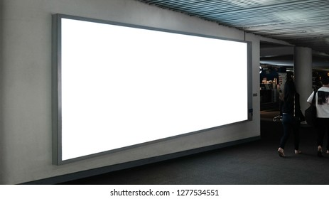 blank advertising billboard at airport,Mock up Poster media template Ads display in Subway station escalator