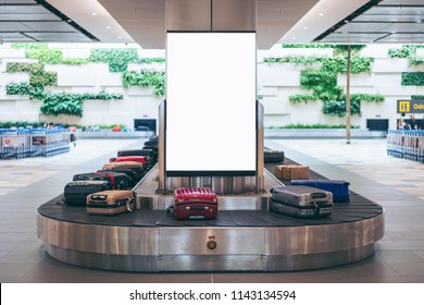 Blank advertising billboard with baggage and luggage in the international airport