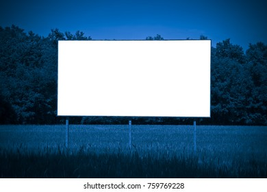 Blank advertising billboard immersed in a rural scene - image with copy space