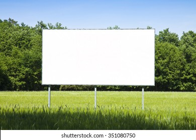 A blank advertising billboard immersed in a wheat field