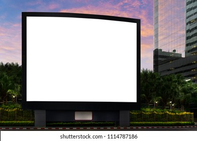Blank advertising billboard LCD advertisement for adjust your message at modern building in the city with nice sky in evening time, mock up selective focus with clipping path.