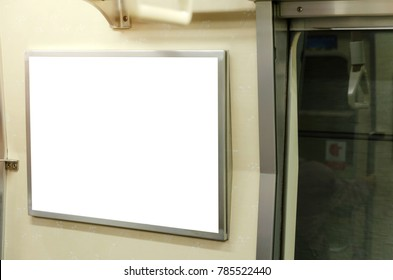 blank advertising billboard or light box showcase on wall inside subway train at station, copy space for your text message or media content, advertisement, commercial and marketing concept