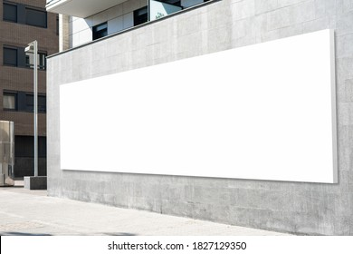 Blank advertising billboard on building wall useful for products advertisement