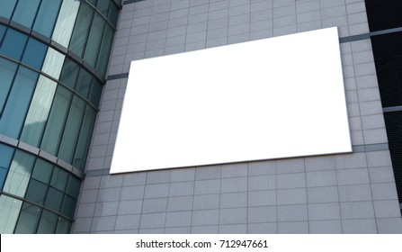 Blank advertising billboard on modern office building wall useful for products advertisement