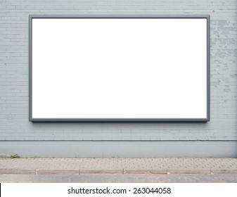 Blank advertising billboard on a street wall.
