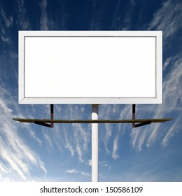 Blank advertising billboard outdoors against blue sky background