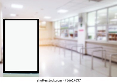 blank advertising billboard or showcase light box with copy space for your text message or media and content in waiting zone for pay money and receive medicine at cashier pharmacy counter at hospital