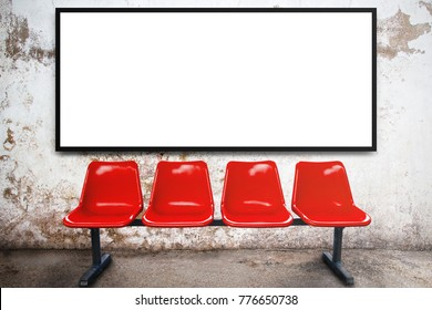 Blank advertising billboard or wide screen television and red chair with old vintage buildings exterior brick wall background, commercial and marketing concept, copy space for text or media content.