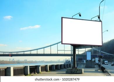 Blank advertising board on city street